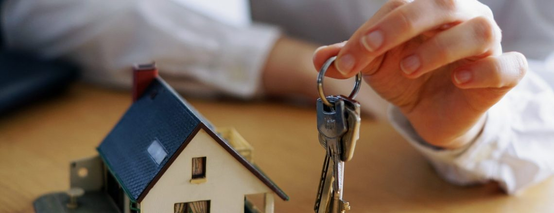 A closeup shot of a person thinking of buying or selling a house