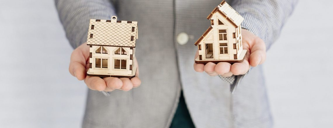 realtor-holding-house-figurines